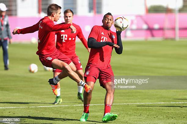 Philipp Lahm of Bayern Muenchen battles for the ball with his team mate Jerome Boateng during a training session at Bayern Muenchen's trainings...