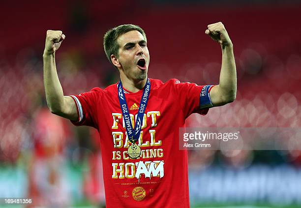 Philipp Lahm of Bayern Muenchen celebrates after winning the UEFA Champions League final match against Borussia Dortmund at Wembley Stadium on May 25...