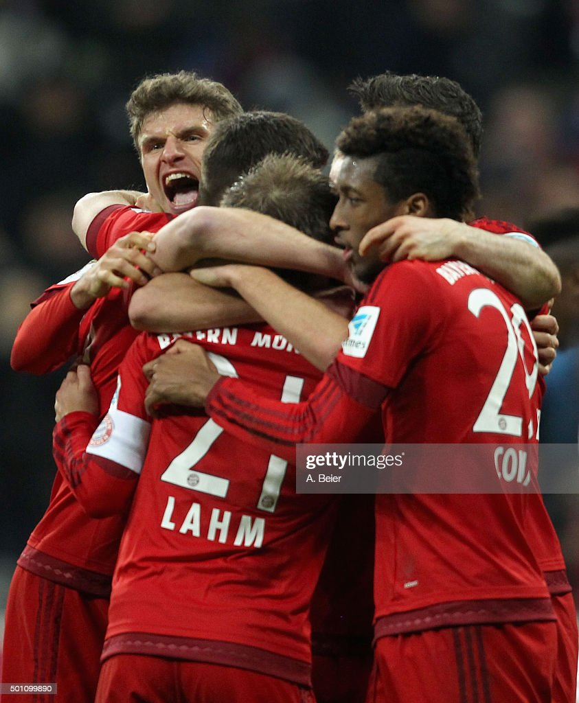 Philipp Lahm (3rdL) of Bayern Muenchen celebrates his goal with his teammates Thomas Mueller and Kingsley Coman (L-R) during the Bundesliga match between FC Bayern Muenchen and FC Ingolstadt at Allianz Arena on December 12, 2015 in Munich, Germany.