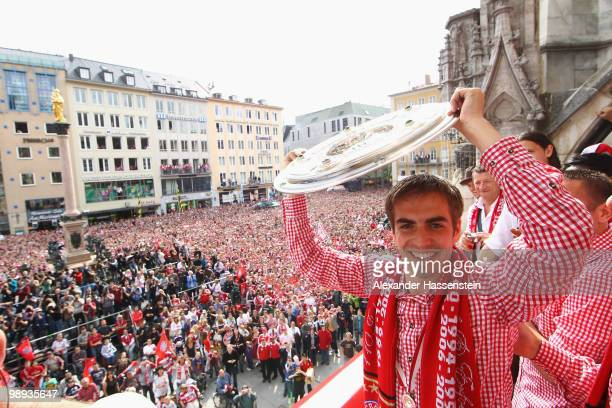 Philipp Lahm of Bayern Muenchen celebrates the German championship title on the balcony of the town hall on May 9 2010 in Munich Germany