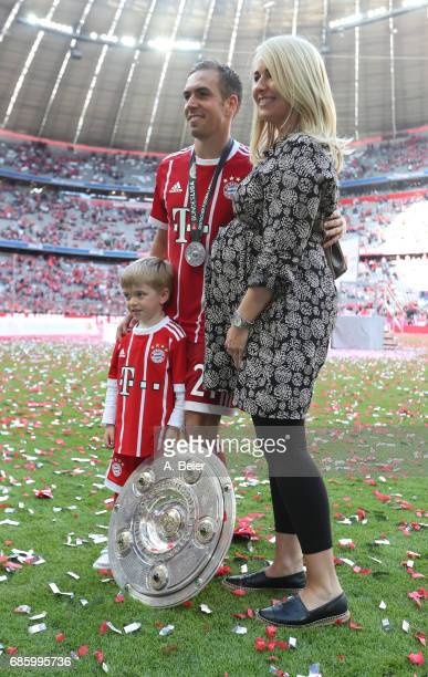 Philipp Lahm of Bayern Muenchen celebrates with his wife Claudia and son Julian following the Bundesliga match between Bayern Muenchen and SC...