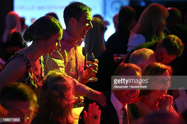Philipp Lahm of Bayern Muenchen celebrates with KarlHeinz Rummenigge CEO of Bayern Muenchen during the Official Champion dinner at Postpalast on May...