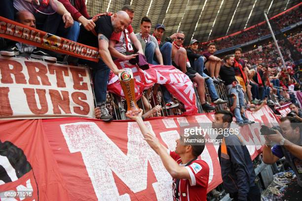 Philipp Lahm of Bayern Muenchen celebrates with the fans after the presentation of the 67th German Championship title following the Bundesliga match...