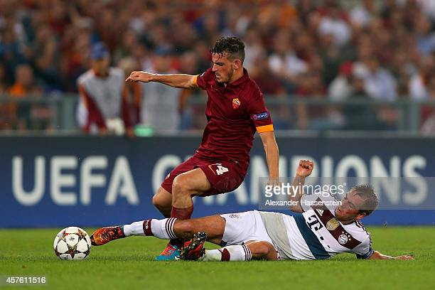 Philipp Lahm of Bayern Muenchen challenges Alessandro Florenzi of AS Roma during the UEFA Champions League group E match between AS Roma and FC...