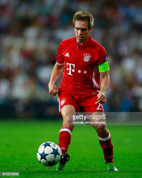 Philipp Lahm of Bayern Muenchen controls the ball during the UEFA Champions League Quarter Final second leg match between Real Madrid CF and FC...