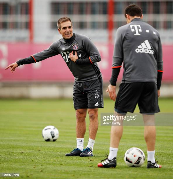 Philipp Lahm of Bayern Muenchen interacts with Xabi Alonso during FC Bayern Muenchen training at Saebener Strasse training ground on March 21 2017 in...