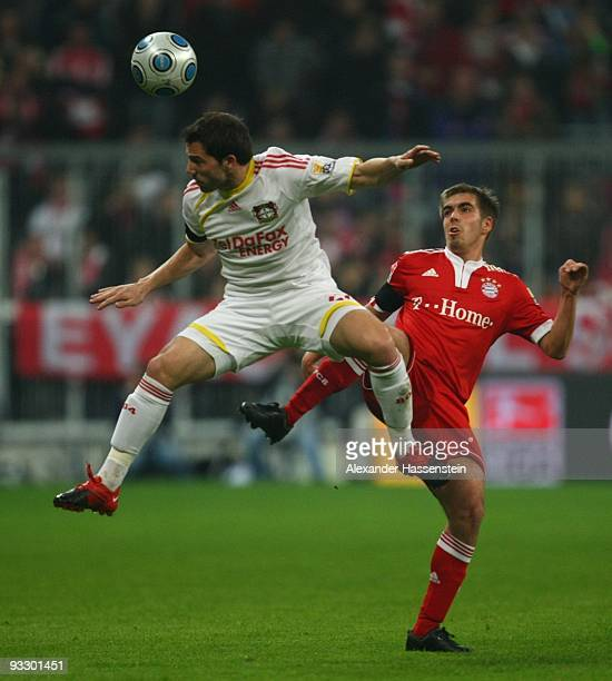 Philipp Lahm of Bayern Muenchen is challenged by Gonzalo Castro of Bayer Leverkusen during the Bundesliga match between FC Bayern Muenchen and Bayer...