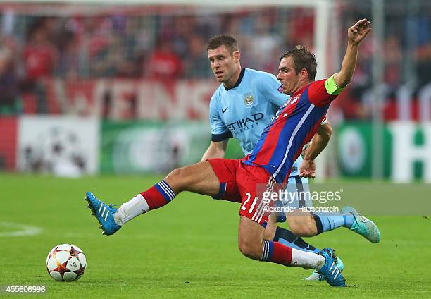 Philipp Lahm of Bayern Muenchen is closed down by James Milner of Manchester City during the UEFA Champions League Group E match between Bayern...