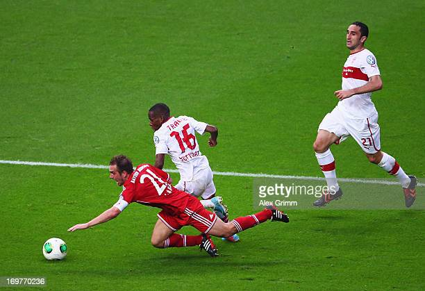 Philipp Lahm of Bayern Muenchen is tripped by Ibrahima Traore of VfB Stuttgart for a penalty during the DFB Cup Final match between FC Bayern...
