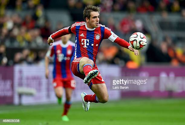 Philipp Lahm of Bayern Muenchen jumps for the ball during the Bundesliga match between Borussia Dortmund and FC Bayern Muenchen at Signal Iduna Park...