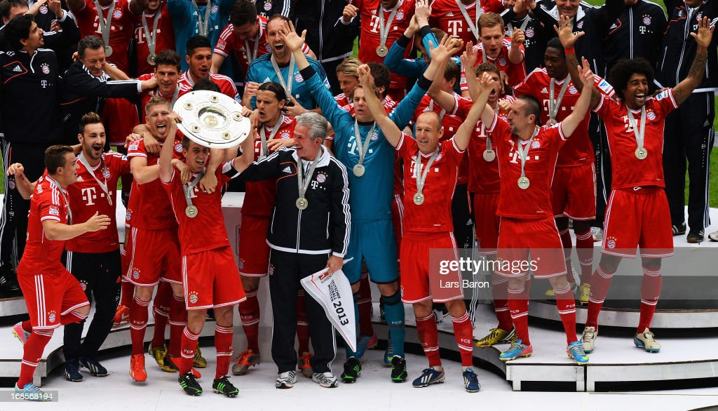 <a gi-track='captionPersonalityLinkClicked' href=/galleries/search?phrase=Philipp+Lahm&family=editorial&specificpeople=483746 ng-click='$event.stopPropagation()'>Philipp Lahm</a> of Bayern Muenchen lifts the Bundesliga trophy with his team-mates following their match against Augsburg at the Allianz Arena on May 11, 2013 in Munich, Germany.
