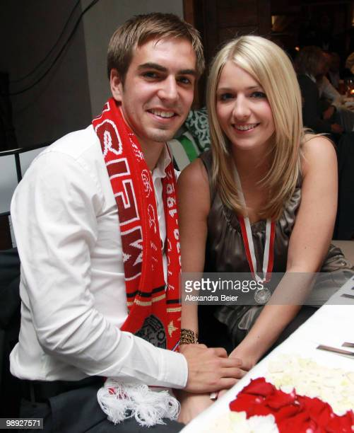 Philipp Lahm of Bayern Muenchen poses with his girlfriend Claudia Schattenberg during a dinner to celebrate their German championship title on May 8...