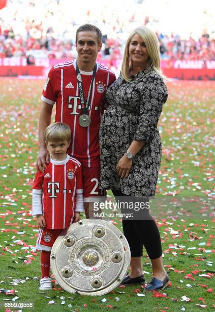 Philipp Lahm of Bayern Muenchen poses with his wife Claudia and his son Julian following the Bundesliga match between Bayern Muenchen and SC Freiburg...
