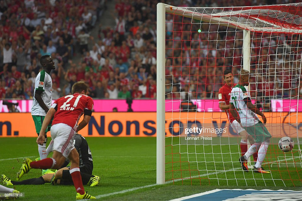 Philipp Lahm of Bayern Muenchen scores his team's fourth goal during the Bundesliga match between Bayern Muenchen and Werder Bremen at Allianz Arena...
