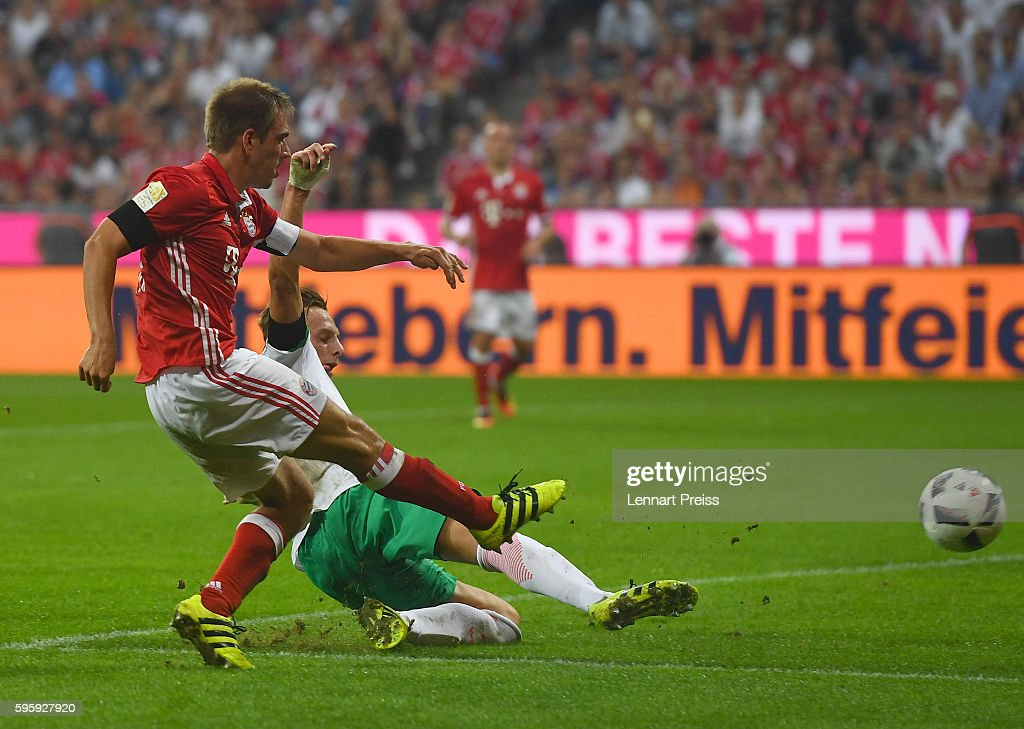 Philipp Lahm (L) of Bayern Muenchen scores his team's fourth goal during the Bundesliga match between Bayern Muenchen and Werder Bremen at Allianz Arena on August 26, 2016 in Munich, Germany.