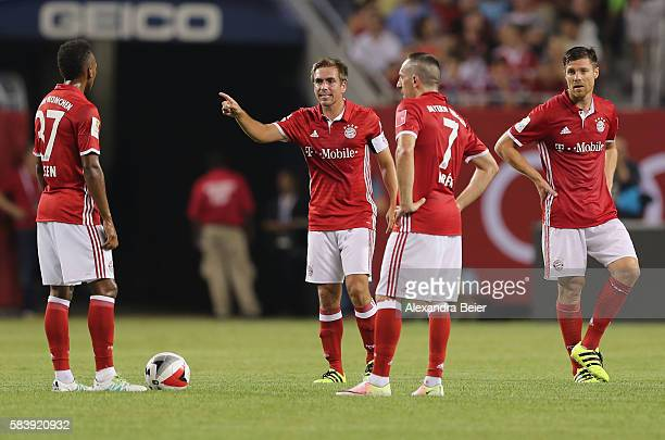 Philipp Lahm of Bayern Muenchen speaks to his teammates Julian Green Franck Ribery and Xabi Alonso during the International Champions Cup between FC...