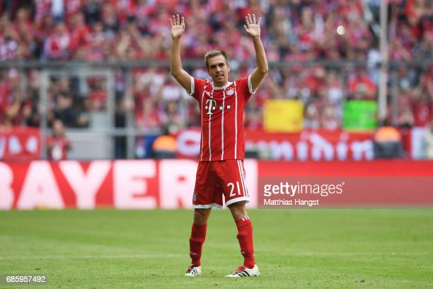 Philipp Lahm of Bayern Muenchen waves to the fans as he leaves the pitch during the Bundesliga match between Bayern Muenchen and SC Freiburg at...