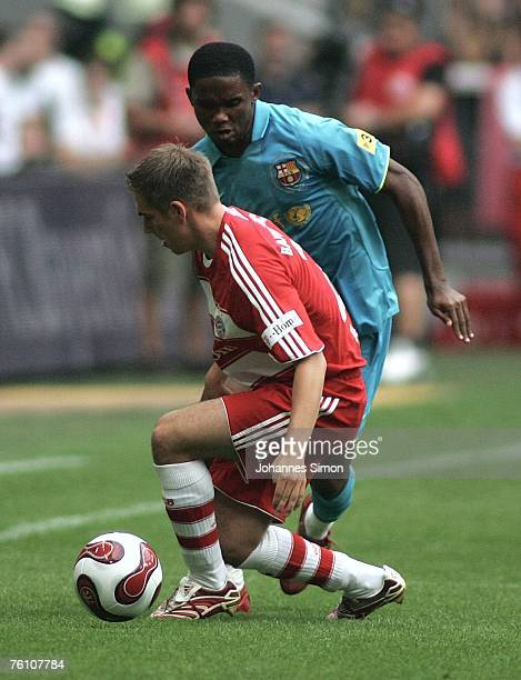 Philipp Lahm of Bayern Munich and Samuel Eto'o of Barcelona in action during the Franz Beckenbauer Cup match between Bayern Munich and Barcelona at...