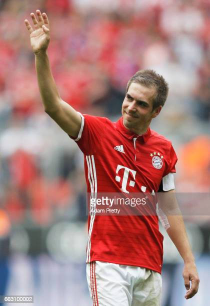 Philipp Lahm of Bayern Munich celebrates after victory in the Bundesliga match between Bayern Muenchen and FC Augsburg at Allianz Arena on April 1...