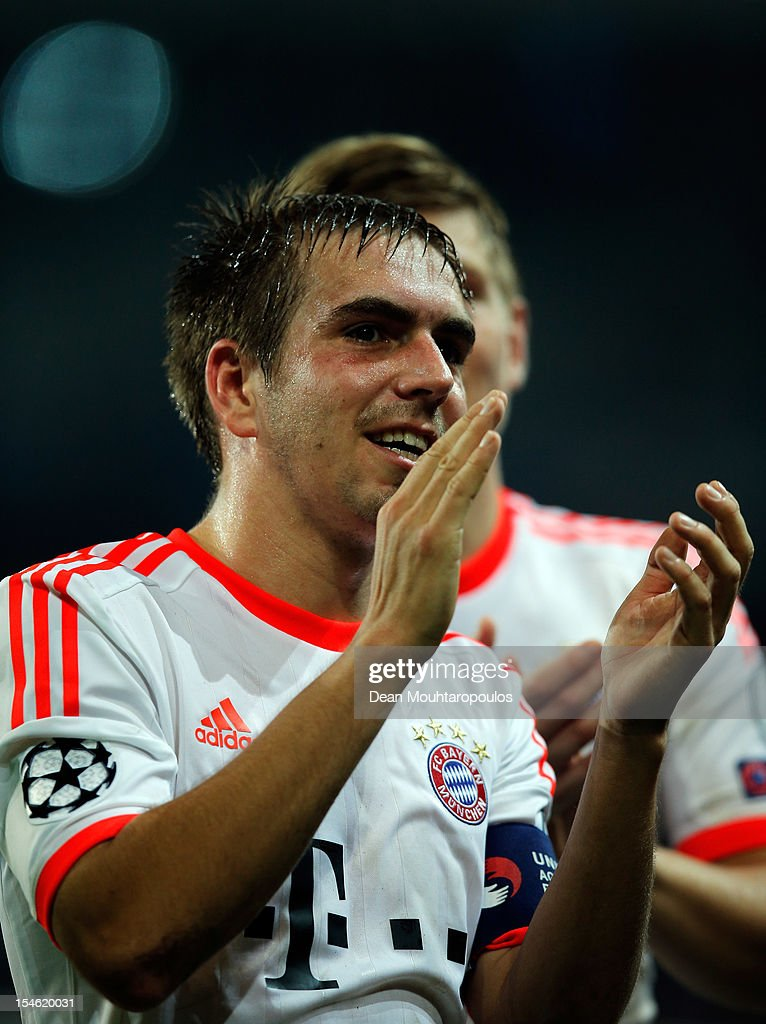 <a gi-track='captionPersonalityLinkClicked' href=/galleries/search?phrase=Philipp+Lahm&family=editorial&specificpeople=483746 ng-click='$event.stopPropagation()'>Philipp Lahm</a> of Bayern Munich celebrates victory with the fans after the Group F UEFA Champions League match between OSC Lille and FC Bayern Muenchen at Grand Stade Lille Metropole on October 23, 2012 in Lille, France.