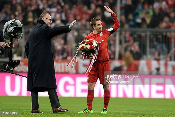 Philipp Lahm of Bayern Munich gets flowers from Bayern Munich's CEO KarlHeinz Rummenigge before the Bundesliga soccer match between FC Bayern Munich...