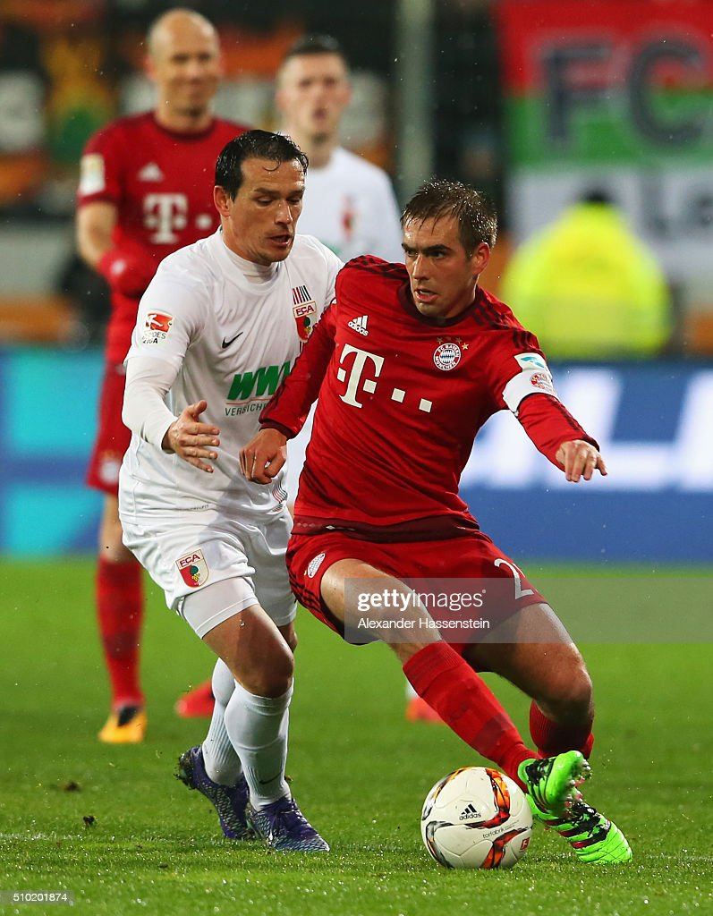 <a gi-track='captionPersonalityLinkClicked' href=/galleries/search?phrase=Philipp+Lahm&family=editorial&specificpeople=483746 ng-click='$event.stopPropagation()'>Philipp Lahm</a> of Bayern Munich holds off <a gi-track='captionPersonalityLinkClicked' href=/galleries/search?phrase=Piotr+Trochowski&family=editorial&specificpeople=635014 ng-click='$event.stopPropagation()'>Piotr Trochowski</a> of Augsburg during the Bundesliga match between FC Augsburg and FC Bayern Muenchen at SGL Arena on February 14, 2016 in Augsburg, Germany.