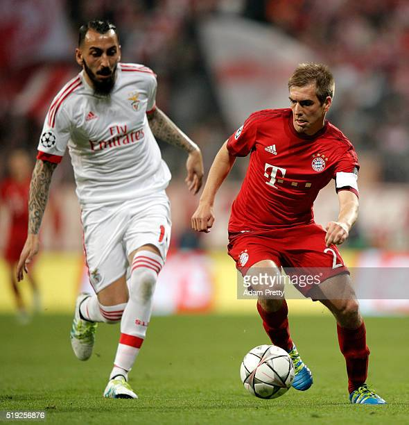 Philipp Lahm of Bayern Munich is chased by Kostas Mitroglou of Benfica during the UEFA Champions League quarter final first leg match between FC...