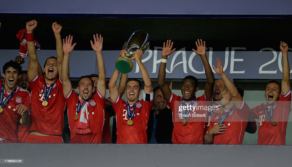 <a gi-track='captionPersonalityLinkClicked' href=/galleries/search?phrase=Philipp+Lahm&family=editorial&specificpeople=483746 ng-click='$event.stopPropagation()'>Philipp Lahm</a> of Bayern Munich lifts the trophy as he celebrates with his team mates during the UEFA Super Cup between Bayern Muenchen and Chelsea at Stadion Eden on August 30, 2013 in Prague, Czech Republic.