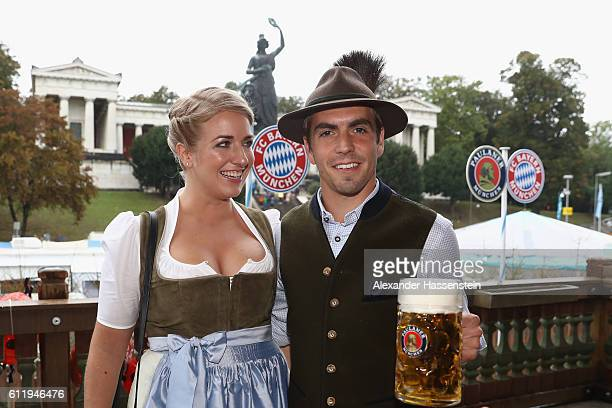 Philipp Lahm of FC Bayern Muenchen and Claudia Lahm attend the Oktoberfest beer festival at Kaefer Wiesenschaenke tent at Theresienwiese on October 2...