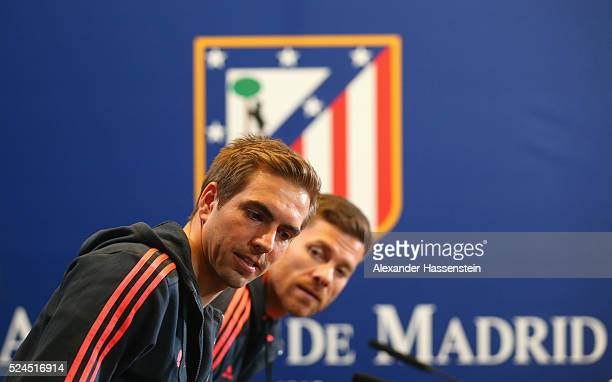 Philipp Lahm of FC Bayern Muenchen arrives with his team mate Xabi Alonso for a FC Bayern Muenchen press conference on the eve of the UEFA Champions...