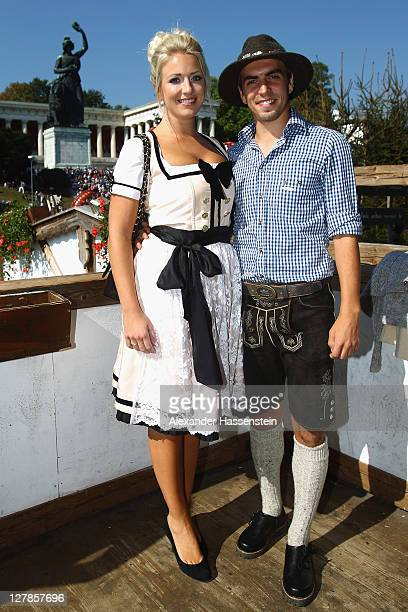 Philipp Lahm of FC Bayern Muenchen attends with his wife Claudia Lahm the Oktoberfest beer festival at the Kaefer Wiesnschaenke tent on October 2...