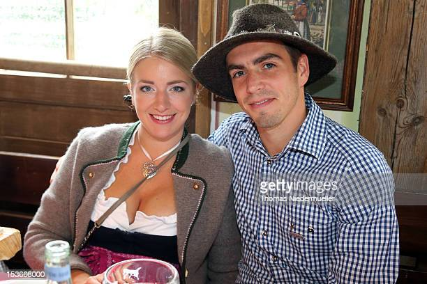 Philipp Lahm of FC Bayern Muenchen attends with his wife Claudia Lahm the Oktoberfest beer festival at the Kaefer Wiesnschaenke tent on October 7...