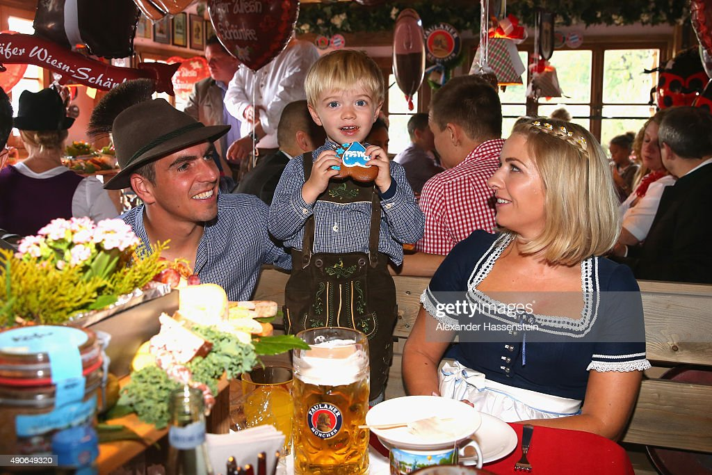 Philipp Lahm of FC Bayern Muenchen attends with his wife Claudia Lahm and his son Julian Lahm the Oktoberfest 2015 Beerfestival at Kaefer Wiesenschaenke at Theresienwiese on September 30, 2015 in Munich, Germany.