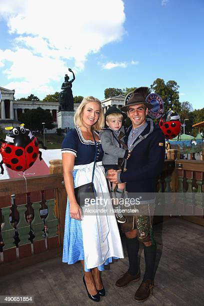 Philipp Lahm of FC Bayern Muenchen attends with his wife Claudia Lahm and his son Julian Lahm the Oktoberfest 2015 Beerfestival at Kaefer...