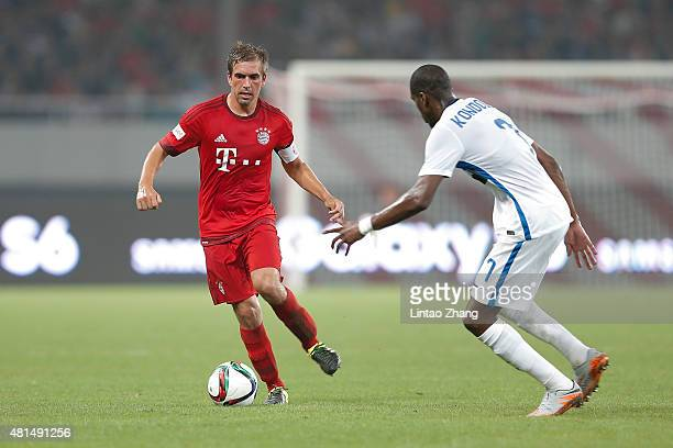 Philipp Lahm of FC Bayern Muenchen challenges Geoffry Kongdogbia of FC Internazionale during the international friendly match between FC Bayern...
