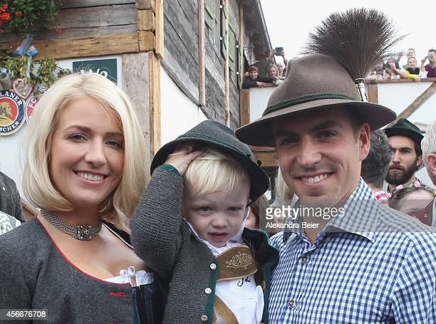 Philipp Lahm of FC Bayern Muenchen his wife Claudia and son Julian attend the Oktoberfest 2014 beer festival at Kaefers Wiesenschaenke at...