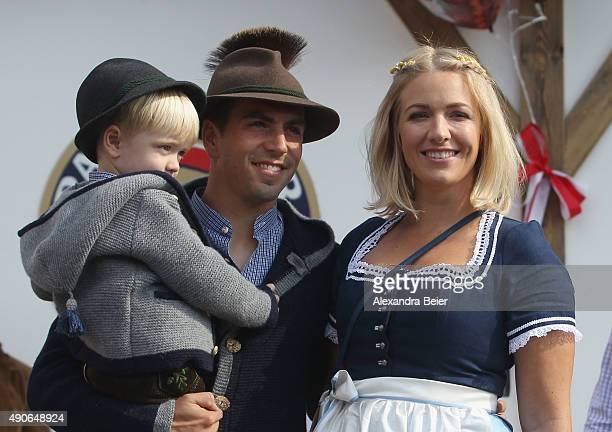 Philipp Lahm of FC Bayern Muenchen his wife Claudia and son Julian attend the Oktoberfest beer festival 2015 at Theresienwiese on September 30 2015...