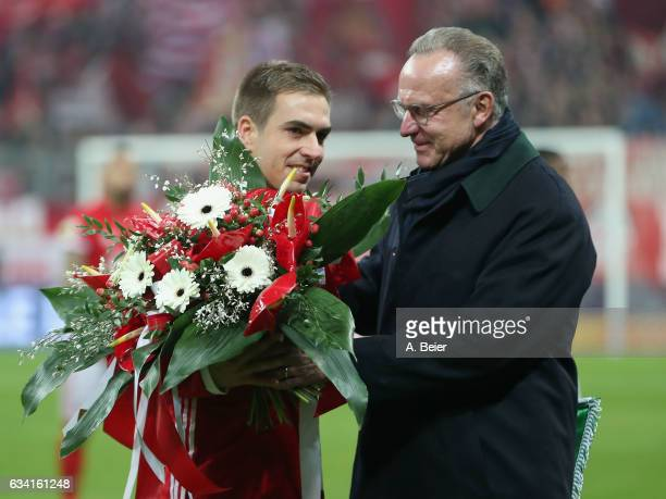 Philipp Lahm of FC Bayern Muenchen is honoured by CEO KarlHeinz Rummenigge for having played his 500th soccer match for FC Bayern Muenchen before the...
