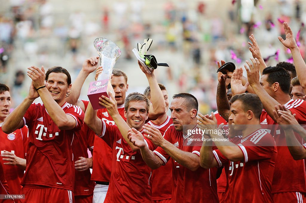 Philipp Lahm of FC Bayern Muenchen lifts the trophy after the Telekom 2013 Cup final between FC Bayern Muenchen and Borussia Moenchengladbach on July 21, 2013 in Moenchengladbach, Germany.