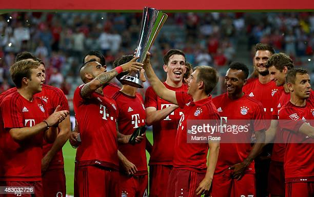 Philipp Lahm of FC Bayern Muenchen lifts the trophy after winning the Audi Cup 2015 final match between FC Bayern Muenchen and Real Madrid at Allianz...