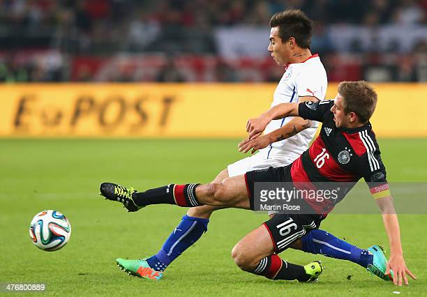 Philipp Lahm of Germany and Eduardo Vargas of Chile battles for the ball during the International Friendly Match between Germany and Chile at...