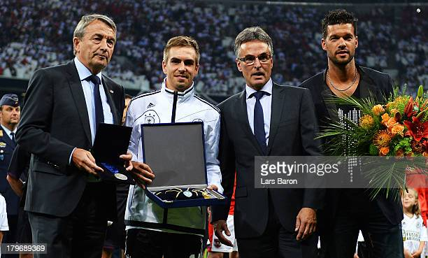 Philipp Lahm of Germany and former player Michael Ballack get honoured by Wolfgang Niersbach president of DFB and Helmut Sandrock General Secretary...