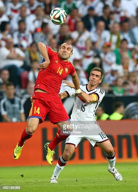 Philipp Lahm of Germany and Movsisyan of Armenia battle for the ball during the International Friendly Match between Germany and Armenia at coface...
