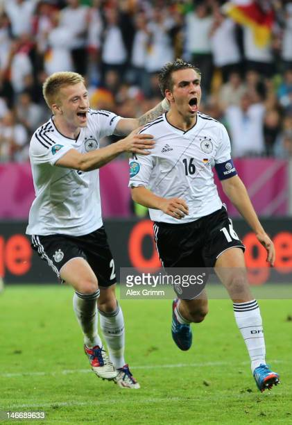 Philipp Lahm of Germany celebrates scoring their first goal with Marco Reus during the UEFA EURO 2012 quarter final match between Germany and Greece...