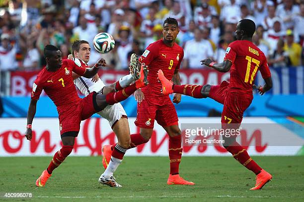Philipp Lahm of Germany competes for the ball with Christian Atsu and Mohammed Rabiu of Ghana during the 2014 FIFA World Cup Brazil Group G match...