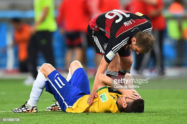 Philipp Lahm of Germany consoles Oscar of Brazil after Germany's 71 win during the 2014 FIFA World Cup Brazil Semi Final match between Brazil and...