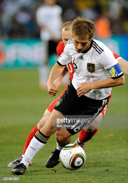 Philipp Lahm of Germany dribbles during the 2010 FIFA World Cup South Africa Round of Sixteen match between Germany and England at Free State Stadium...