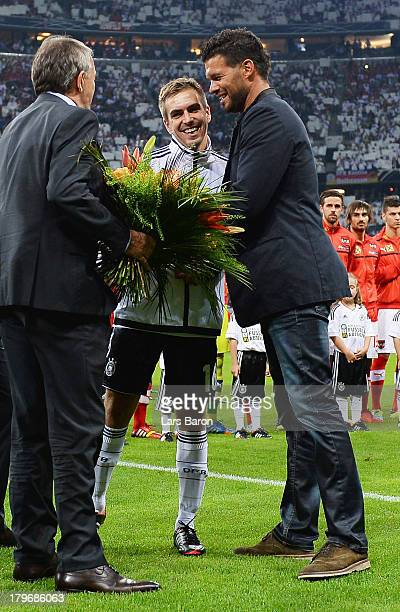 Philipp Lahm of Germany hughs Michael Ballack during the FIFA 2014 World Cup Qualifying Group C match between Germany and Austria>> on September 6...