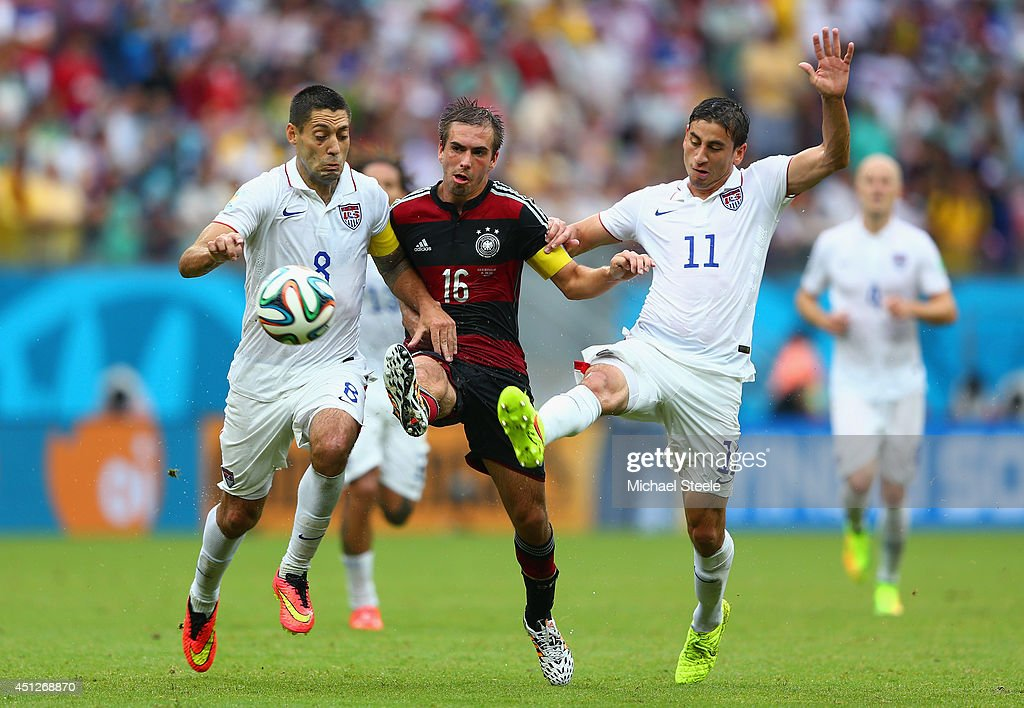 <a gi-track='captionPersonalityLinkClicked' href=/galleries/search?phrase=Philipp+Lahm&family=editorial&specificpeople=483746 ng-click='$event.stopPropagation()'>Philipp Lahm</a> of Germany is challenged by <a gi-track='captionPersonalityLinkClicked' href=/galleries/search?phrase=Clint+Dempsey&family=editorial&specificpeople=547866 ng-click='$event.stopPropagation()'>Clint Dempsey</a> (L) and <a gi-track='captionPersonalityLinkClicked' href=/galleries/search?phrase=Alejandro+Bedoya&family=editorial&specificpeople=6703886 ng-click='$event.stopPropagation()'>Alejandro Bedoya</a> of the United States during the 2014 FIFA World Cup Brazil group G match between the United States and Germany at Arena Pernambuco on June 26, 2014 in Recife, Brazil.