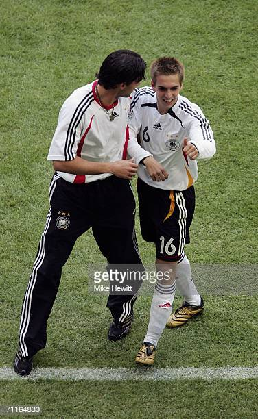 Philipp Lahm of Germany is congratulated by teammate Michael Ballack after scoring the opening goal during the FIFA World Cup Germany 2006 Group A...